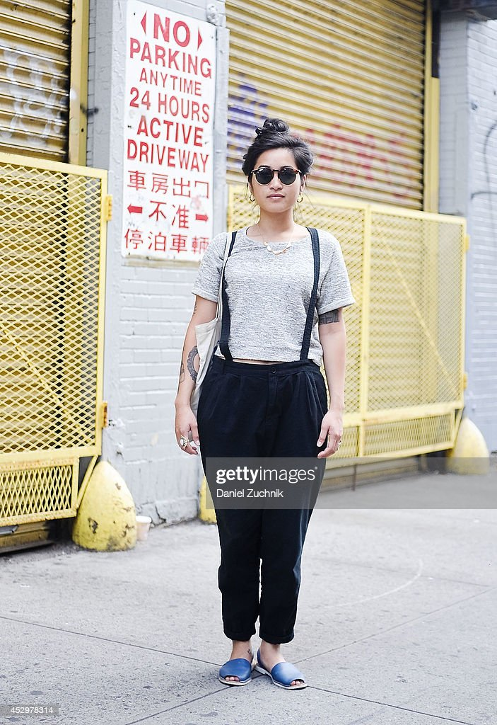 Bartender Amara is seen around Nolita wearing a vintage outfit with a Topshop necklace on July 31, 2014 in New York City.