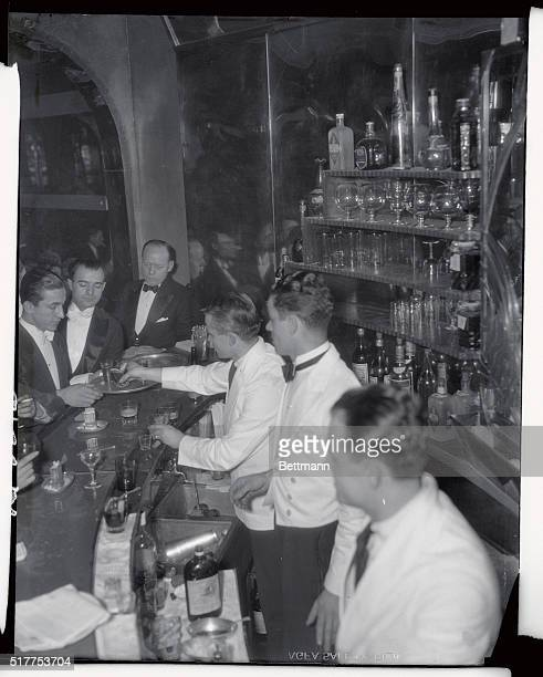 A bartender at the Marlborough Club at 16 East 61st puts drinks on a waiters tray to be carried to a table to be disposed of in the proper manner...