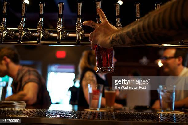 Bartender Ben Brown pours beers from the tap at Meridian Pint on a recent Friday night According to the restaurant's general manager Drew Swift half...