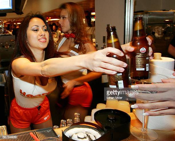Bartender Bernie De Guzman serves drinks at the Hooters Restaurant during the grand opening of the Hooters Casino Hotel February 2 2006 in Las Vegas...