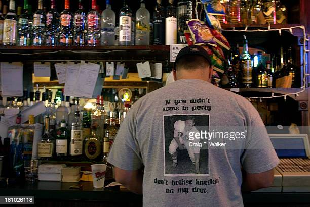 COLLINS SEPTEMBER 22 2004 Bartender Brian Mattison works behind the bar at Sullivan's Sports Tavern in Fort Collins CO The tshirt shows a photograph...