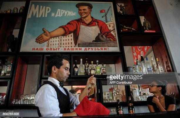 A bartender cleans a bottle of rum at the retroSoviet restaurant Nazdarovie in Havana on October 16 2017 With three decades of close alliance with...