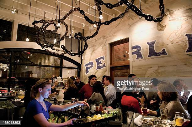 Bartender Elizabeth Flangan works at Pearl Dive Oyster Palace on Tuesday November 22 2011 in Washington DC Jeff Black is the owner and chef of the...