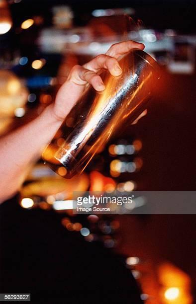 Bartender holding cocktail shaker