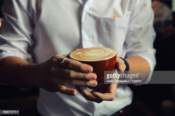 Bartender Holding Coffee Cup