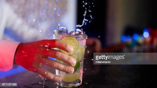 Bartender holding mojito