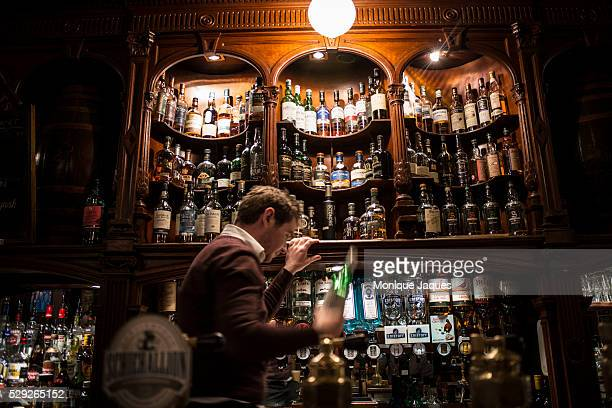 A bartender Kevin at Bennets one of the oldest pubs in Scotland on June 15th 2014 Bennets boats a wide variety of locally made Scottish whiskey and...