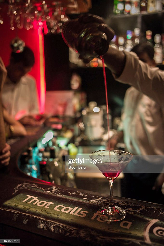 A Bartender Makes A Cocktail At The Living Room Bar In The Hauz Khas Area In Part 49