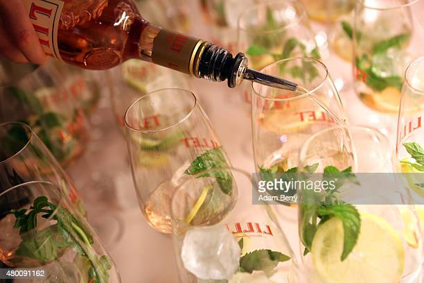 A bartender makes a Lillet aperitif wine mint soda and lemon cocktail at the Augustin Teboul show during MercedesBenz Fashion Week Berlin...
