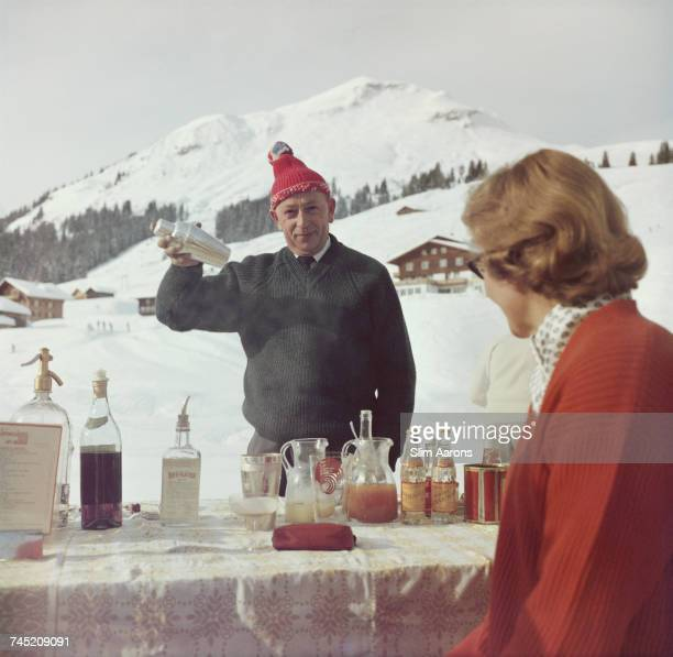 A bartender mixes a drink for a customer at the Ice Bar at the Hotel Krone in Lech Austria 1960