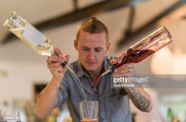 Bartender mixes drinks in bar/restaurant setting