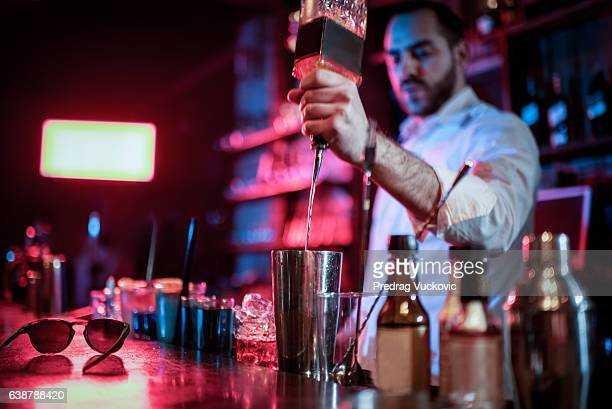 Bartender mixing a cocktail