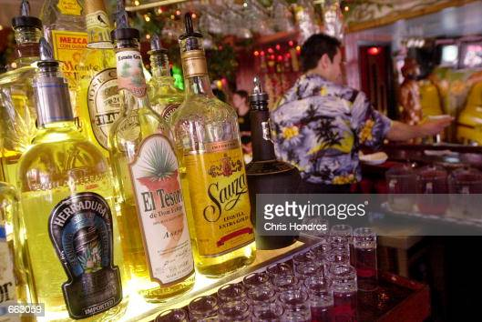 Bartender Omar Castillo makes a margarita at the Caliente Cab bar in Greenwich Village September 27 2000 in New York City Up to 40 percent of the...