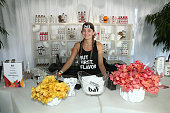 A bartender poses for a photo at the Bai VIP Lounge on day one of The Panorama Music Festival at Randall's Island on July 22 2016 in New York City