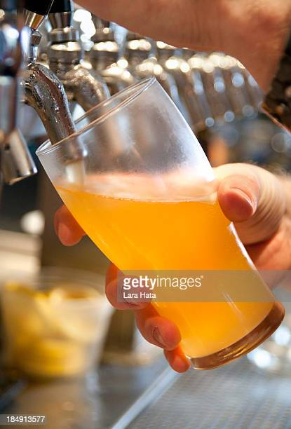 Bartender pouring beer into a glass from the tap