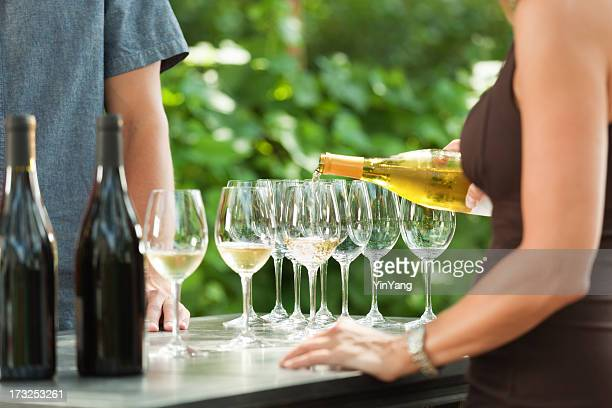 Bartender Pouring White Wine from Bottle for Outdoor Winery Tasting