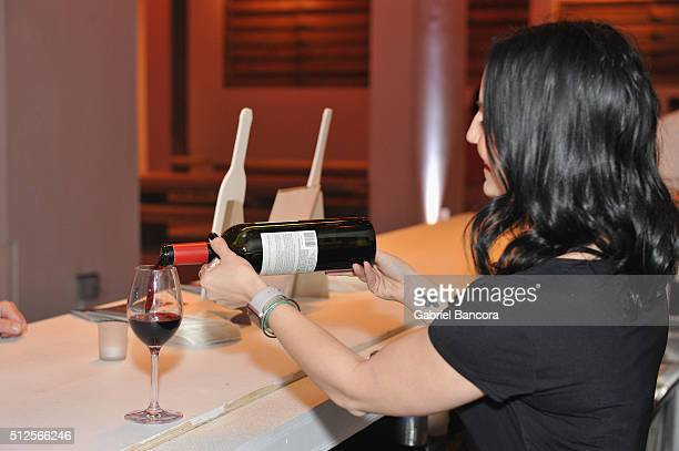 Bartender pours 1865 Cabernet Sauvignon during a Dinner Hosted By Alex Chang And Tom Colicchio during 2016 Food Network Cooking Channel South Beach...