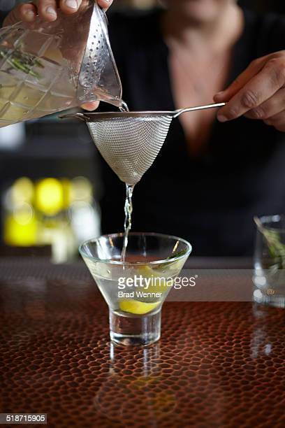 Bartender pours cocktail