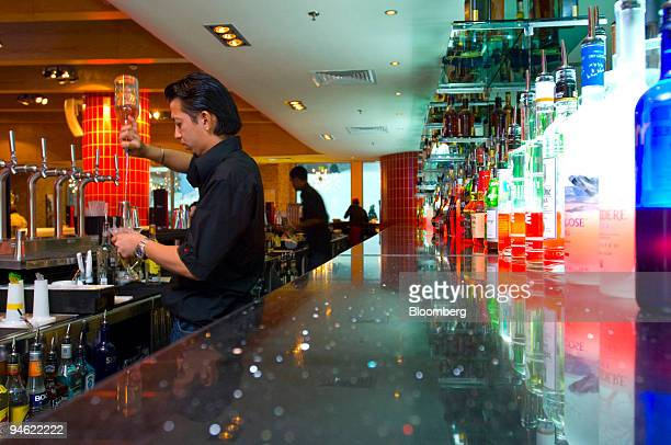 A bartender prepares a drink at 'Apres' a cocktail lounge bar and restaurant at the Mall of the Emirates in Dubai United Arab Emirates Sunday April...