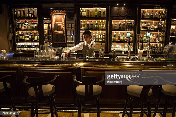 A bartender prepares a drink at the Gallery Bar in the ShangriLa Asia Ltd Hotel at night in Yangon Myanmar on Thursday Feb 4 2016 Aung San Suu Kyi's...