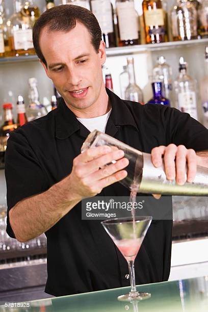 Bartender preparing a martini