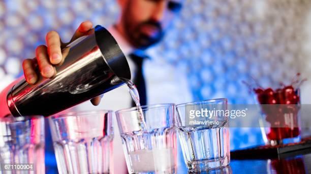 Bartender preparing cocktails in cocktail bar