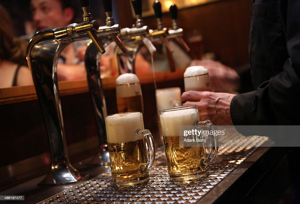 A bartender serves beers at the Alt Berlin (Old Berlin) bar on April 22, 2014 in Berlin, Germany. The bar, which opened in 1893 and is known for its familial atmosphere, is claimed to be the oldest bar in the German capital, a city with few remaining pre-War drinking establishments in comparison to other major European cities. A petition has been launched to convince the bar's landlord to allow the business to stay open after its expected closure at the end of the month due to skyrocketing real estate prices in the city's popular and central Mitte neighborhood.