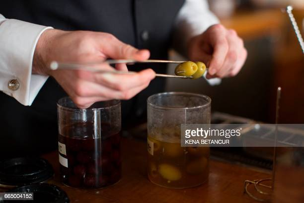 A bartender serves cocktails at the contemporary New York eatery Eleven Madison Park on April 05 2017 in New York The restaurant was crowned the...
