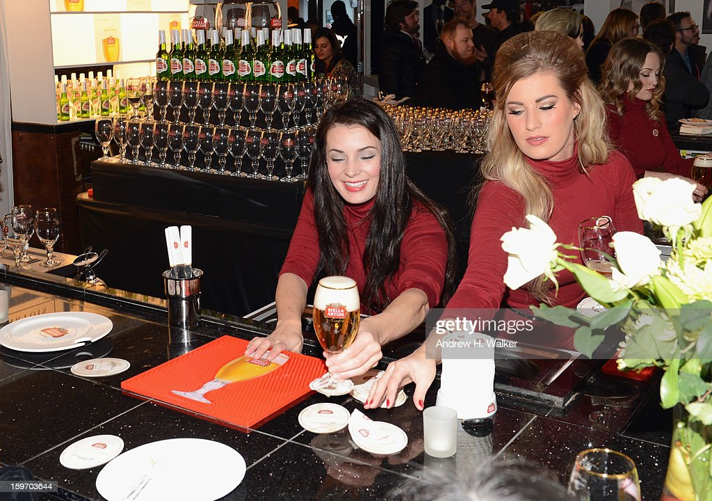 A bartender serves Stella Artois at the Stella Artois launch of the Timeless Beauty Campaign shot by legendary photographer, Annie Leibovitz at Village at the Lift on January 18, 2013 in Park City, Utah.