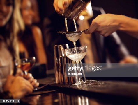 Bartender Serving Cocktail Drinks : Stock Photo