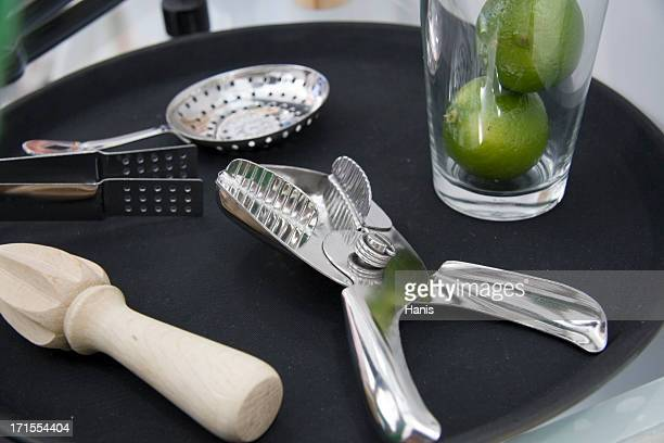 Bartender set with limes in a glass