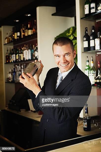 Bartender shaking cocktail