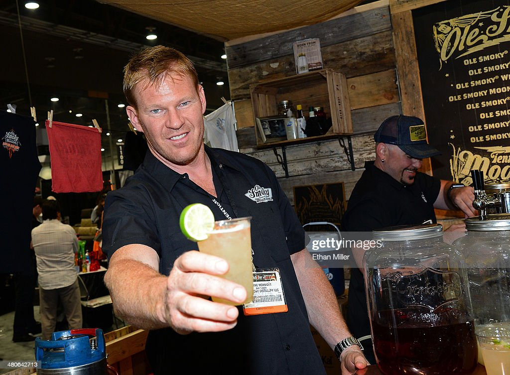 Bartender Shane McKnight poses at the Ole Smoky Tennessee Moonshine booth at the 29th annual Nightclub & Bar Convention and Trade Show at the Las Vegas Convention Center on March 25, 2014 in Las Vegas, Nevada.