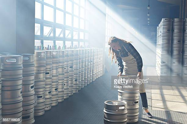 Bartender sorting out beer keg's at microbrewery