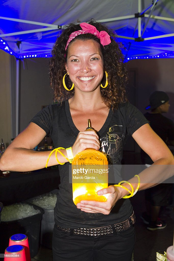 Bartender Tanieca Downing makes a drink with Hennessy before the start of the 2 Chainz concert at Aloha Tower Marketplace on January 24, 2013 in Honolulu, Hawaii.