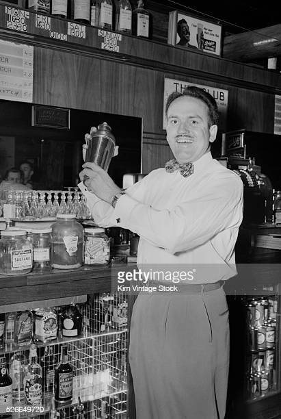 A bartender uses a shaker to make a mixed drink in a postWorld War II Maryland tavern