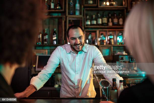 Bartender welcoming customers