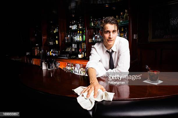 Bartender Wiping Down Bar