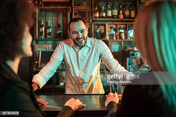 Bartender with customers