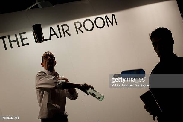 Bartenders juggle with bottles during the MixShake congress at 'El Matadero' on April 9 2014 in Madrid Spain MixShake is a conference for...