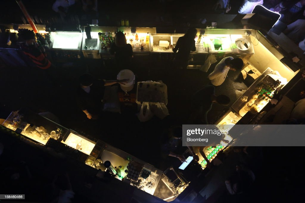 Bartenders serve customers at the bar inside Club Ellui in the Gangnam district of Seoul, South Korea, on Sunday, Dec. 16, 2012. South Koreans vote on Dec. 19 to replace President Lee Myung Bak, whose five-year term ends in February. Photographer: SeongJoon Cho/Bloomberg via Getty Images