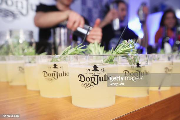 Bartenders serve refreshments as Brit Co Kicks Off Experiential PopUp #CreateGood with Allison Williams and Daphne Oz at Brit Co on October 4 2017 in...