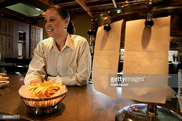 –Bartender/waitress Tracey Williams at Taleo Mexican Grill says her tips fell a week after nearby New Century Financial Corp went bankrupt and laid...