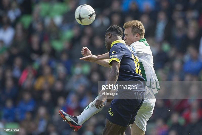 Bartholomew Ogbeche of SC Cambuur Maikel Kieftenbeld of FC Groningen during the Dutch Eredivisie match between FC Groningen and Cambuur Leeuwarden at...