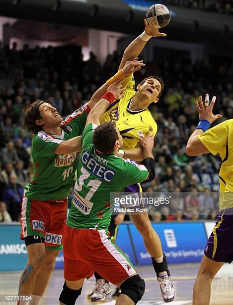 Bartlomiej Jaszka of Berlin is attacked by Fabian van Olphen of Magdeburg and his team mate Bartosz Jurecki during the Toyota Handball Bundesliga...