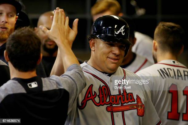 Bartolo Colon of the Atlanta Braves celebrates with teammates after scoring a run in the third inning against the Milwaukee Brewers at Miller Park on...