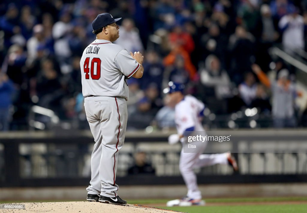 Bartolo Colon #40 of the Atlanta Braves reacts as Jay Bruce #19 of the New York Mets rounds the bases after a solo home run in the fifth inning on April 5, 2017 at Citi Field in the Flushing neighborhood of the Queens borough of New York City.
