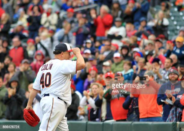 Bartolo Colon of the Minnesota Twins is cheered by fans as leaves the game against the Detroit Tigers in the seventh inning during their baseball...