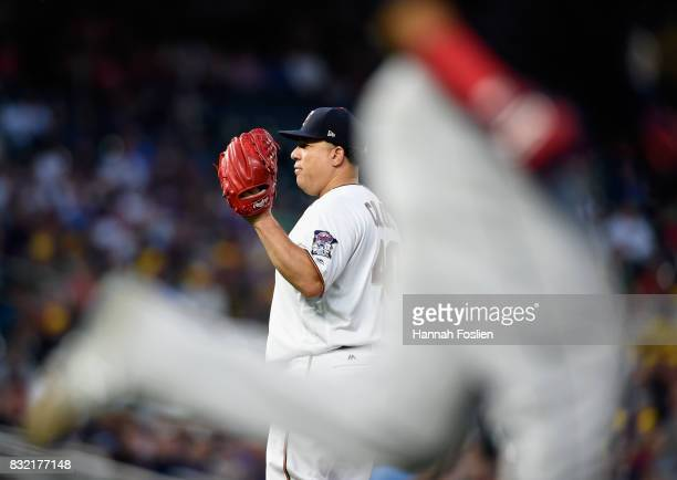 Bartolo Colon of the Minnesota Twins reacts as Carlos Santana of the Cleveland Indians rounds the bases after hitting a solo home run during the...