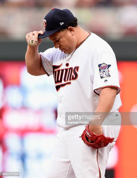 Bartolo Colon of the Minnesota Twins reacts to being called for a balk against the Cleveland Indians during the first inning of the game on August 15...